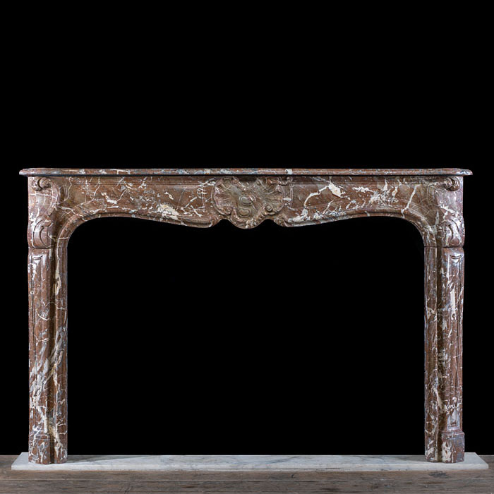 A Rouge Marble Louis XV Chimneypiece