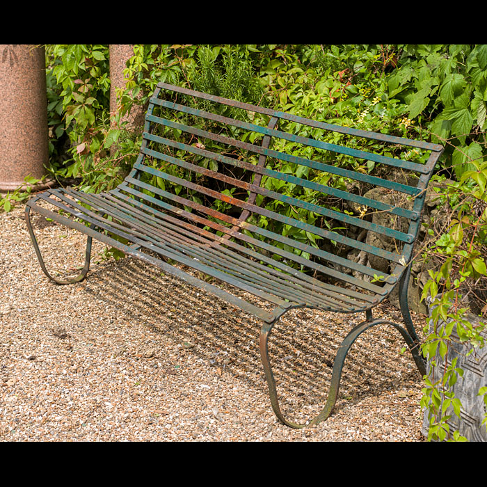 A Victorian wrought iron garden bench