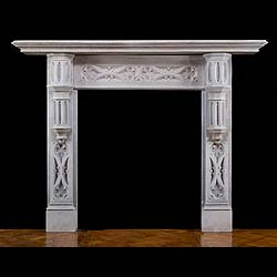A composition stone Gothic Revival chimneypiece