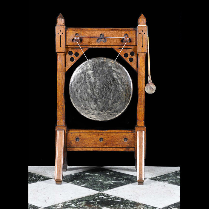 An Antique Arts & Crafts Oak Dinner Gong