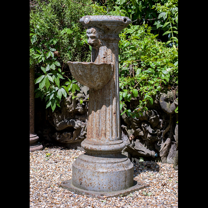 A Small Cast Iron Public Drinking Fountain