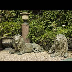 A Pair of Large Patinated Bronze Lions