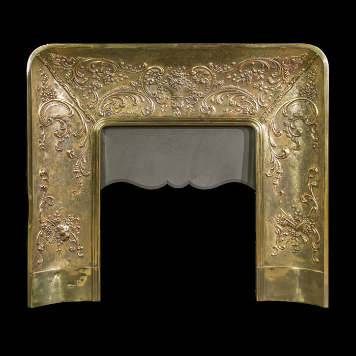 A Louis XVI style antique brass fireplace insert