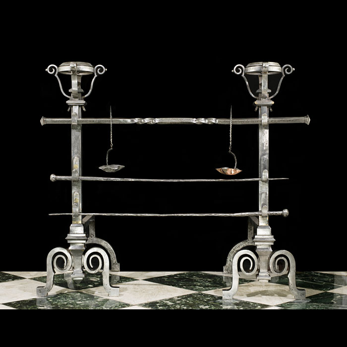 A pair of large antique Jacobean style wrought iron andirons