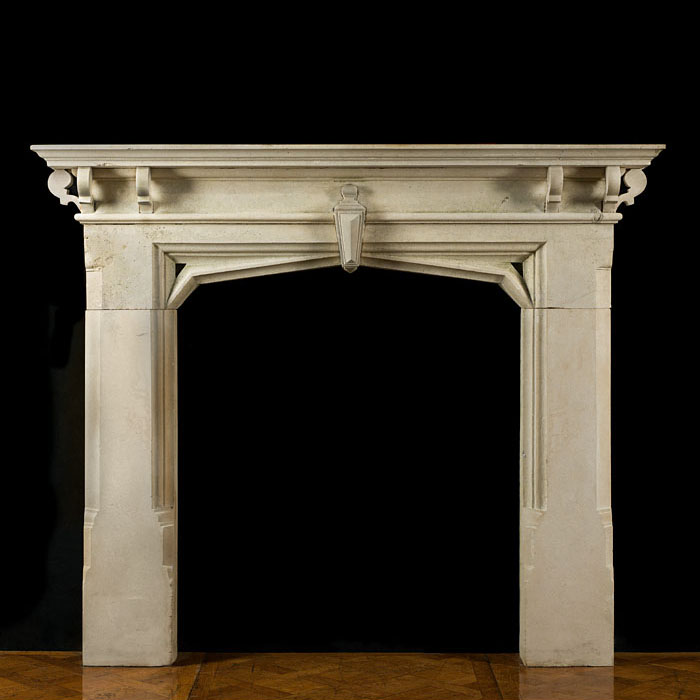 A Limestone Gothic Revival Antique Fireplace