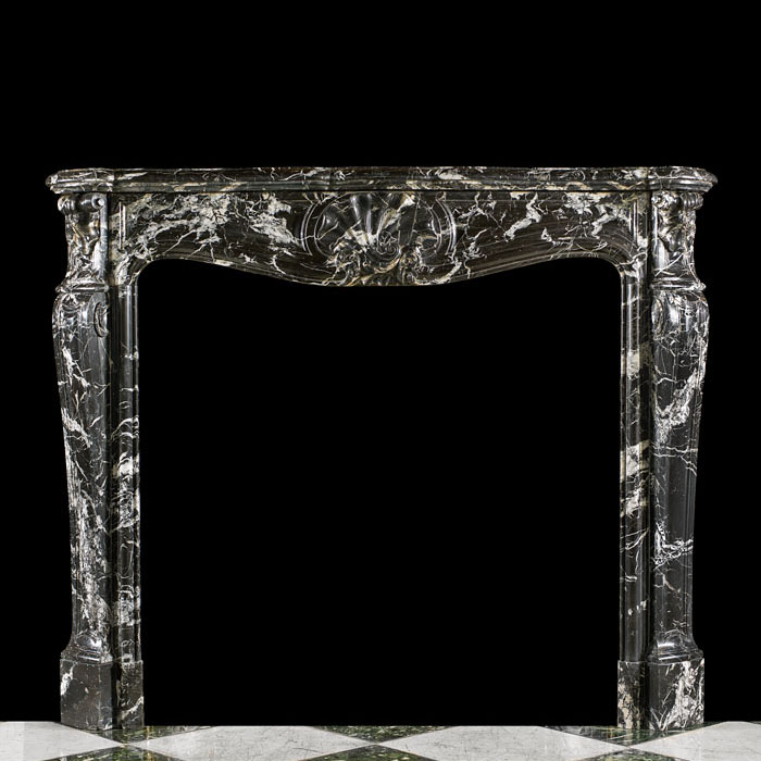 A Tall Louis XV Style Rococo Chimneypiece.