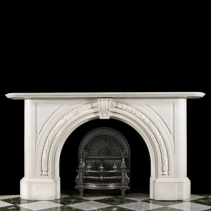 A Large Victorian Arched Marble Fireplace
