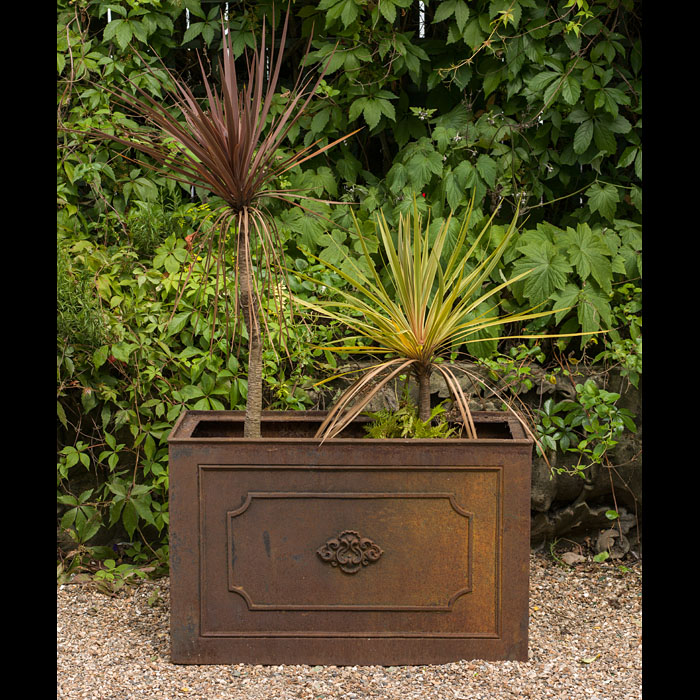 A large antique cast iron garden planter.