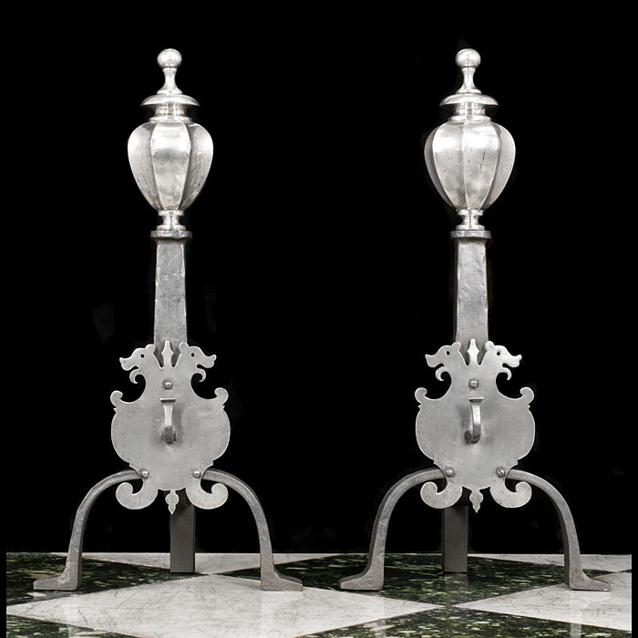 A large pair of Victorian silver plated brass and wrought iron andirons