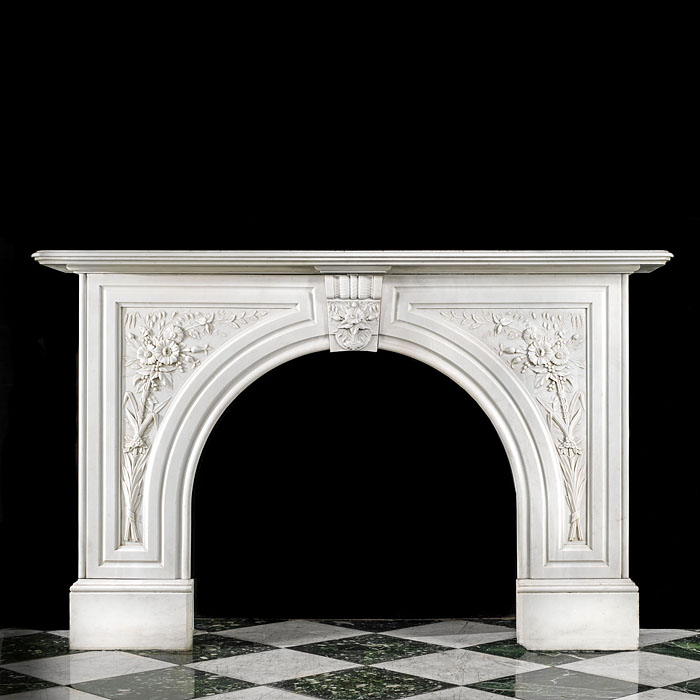 A white marble antique arched Victorian fireplace