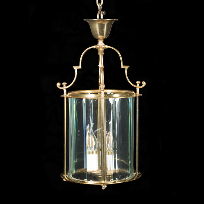 A Brass and bevelled glass hall lantern