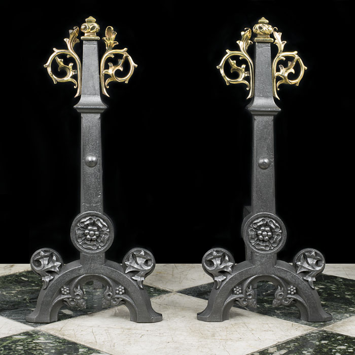 A Victorian pair of tall iron and brass andirons in the Tudor Gothic manner