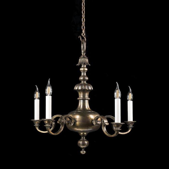 A patinated brass Baroque style chandelier