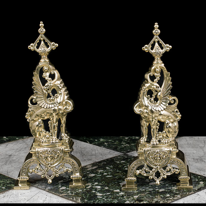 A Pair of French Brass Griffin Andirons