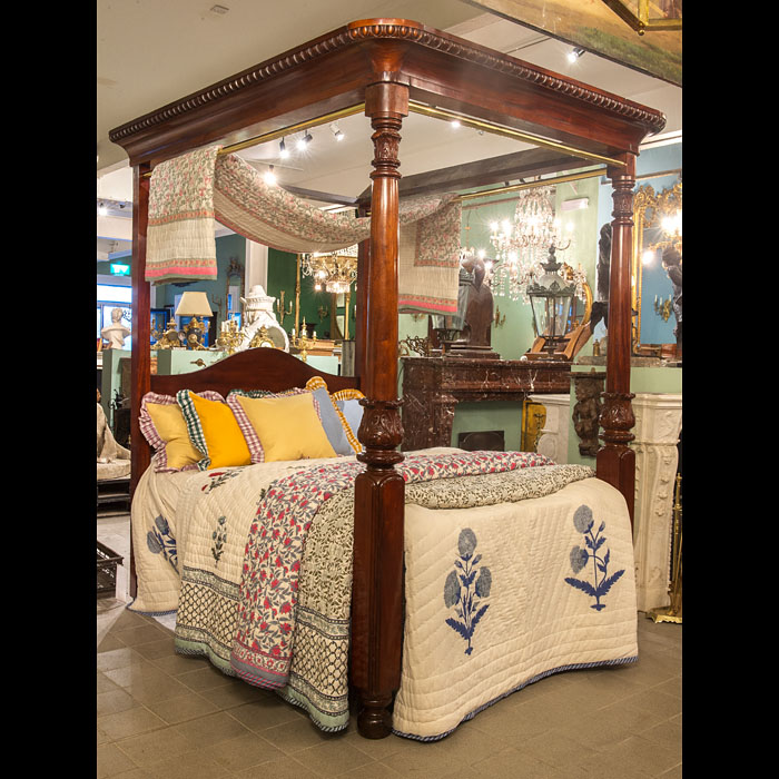 An elegant Regency four poster bed