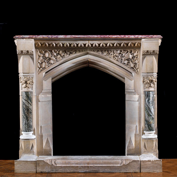 A stone Pugin Gothic Revival fireplace