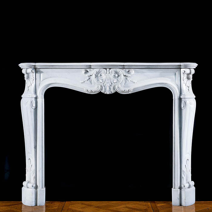 A Louis XV Carrara Marble fire surround