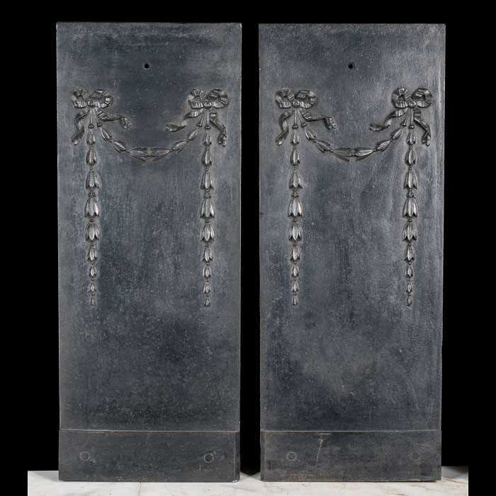 A cast iron pair of bellflower fireplace inserts