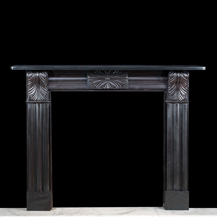 A black slate Regency corbel chimneypiece