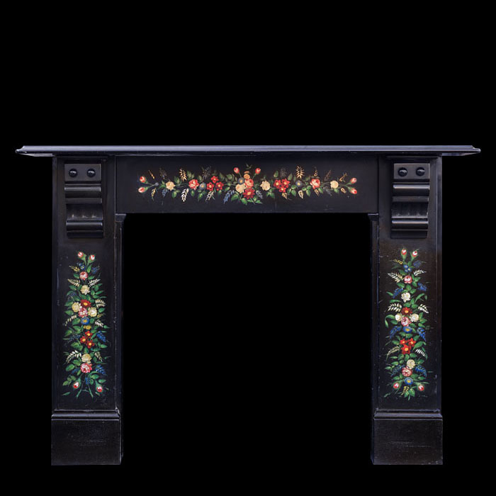 A black slate Victorian painted fireplace