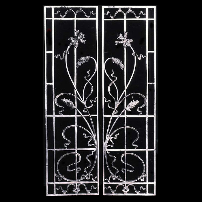 Art Nouveau pair of wrought iron grilles