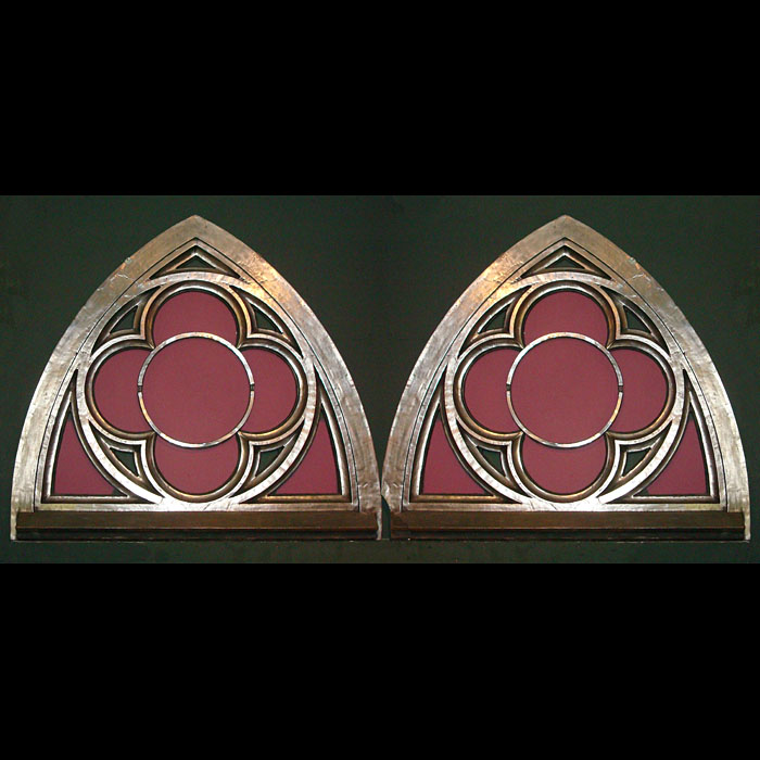 A pair of antique cast iron Gothic arched window frames