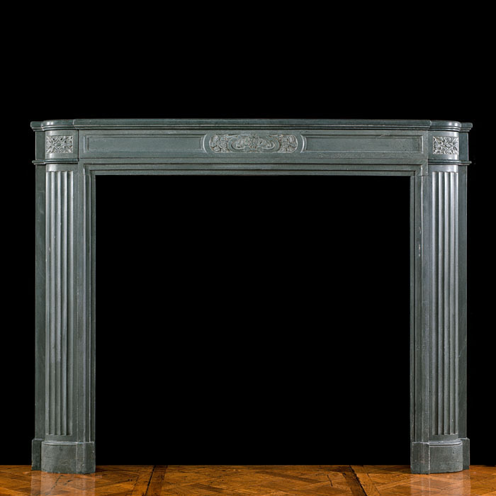 A stone chimneypiece of the Art Deco period
