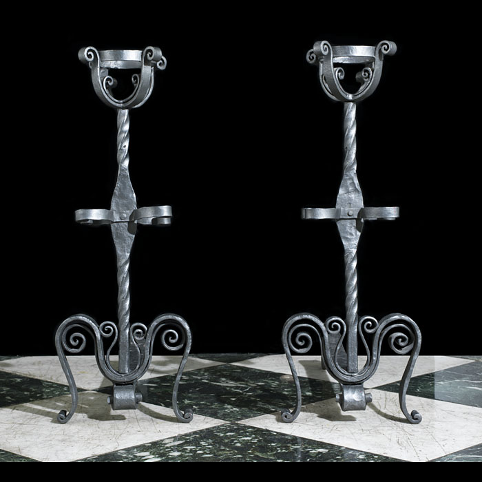 A pair of antique cresset Jacobean style andirons